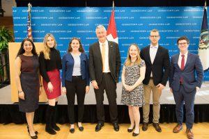 Mansi Gaur (L'22), Grace Stokan (L'20), Laurie Morgan (L'20), Ambassador Jacques Pitteloud, Amy Uihlein (L'20), Lukas Lanzrein (LL.M.'20) and James Carey (L'21).