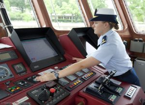 Melissa McCafferty on a boat patrol checking the controls.
