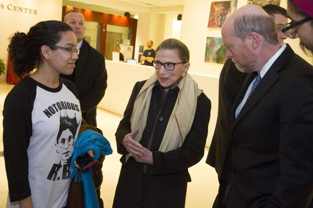Ruth Bader Ginsburg, accompanied with Dean Treanor, meets with a student in Hotung Building.