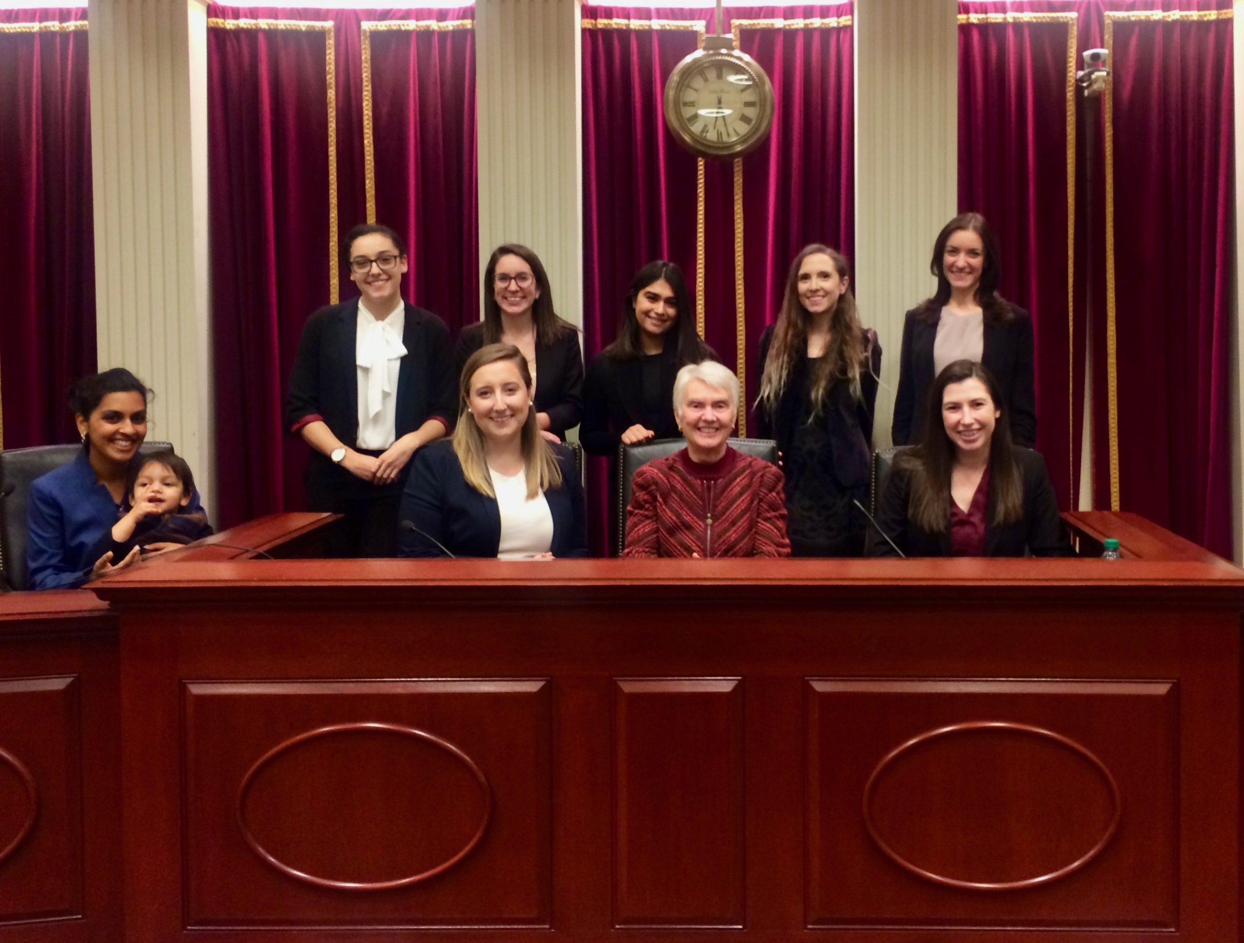 Fall semester Student Advocates Karuna Srivastav, Kayla Svihovec, Clara Mora, Neilab Rahimzada, Alicia Ceccanese, Amanda Strayer, Hannah Kaufman, and Makenna Osborn with Professor Ross in the Supreme Court Institute Moot Courtroom after wrapping up their final oral arguments.