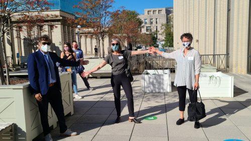 Georgetown Law Professors Anupam Chander, Erin Carroll and Rima Sirota outside of Bernard P. McDonough Hall.