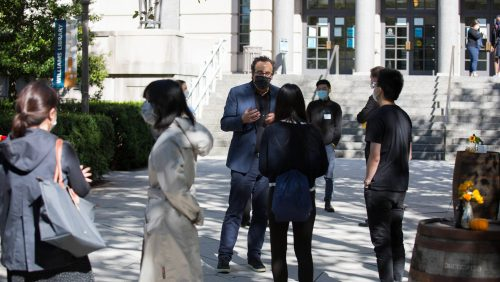 Professor Marty Lederman meets with students outside of the Edward Bennett Williams Law Library.