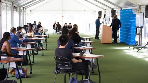 International students holding F-1 visas took part in an in-person class held under a tent on the green outside of the Edward Bennett Williams Law Library.