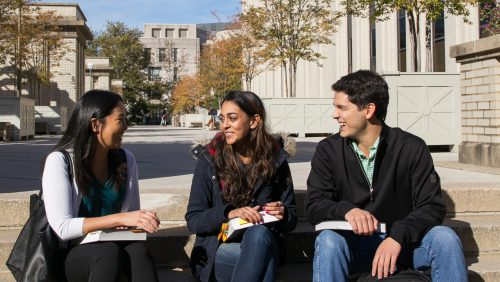 Students studying outside McDonough Hall