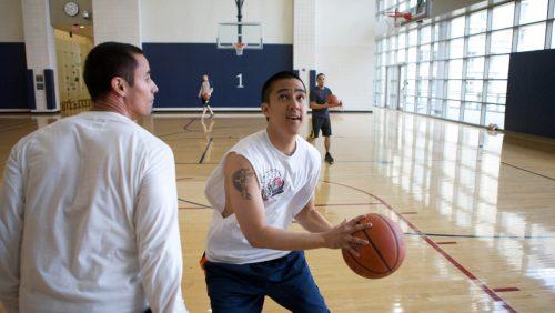 students playing basketball together