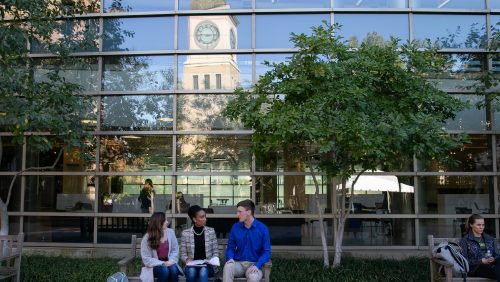 students sitting outside the fitness center