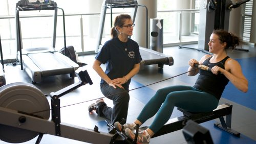student working with personal trainer