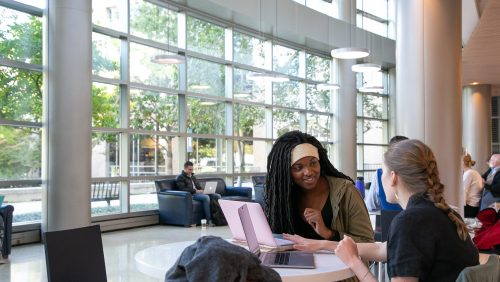students studying in the lobby of the fitness center
