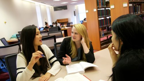 students working together in the law library
