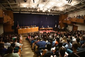 Incoming J.D. students attend a faculty moot court in Hart Auditorium as part of their orientation week.