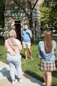 A student ambassador gives a tour around campus.