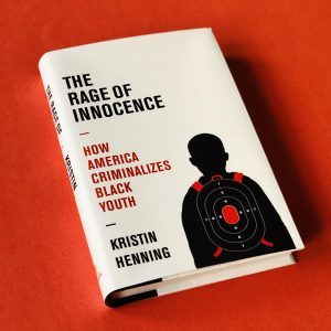 Book cover showing outline of youth with shooting target overlay